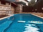 Нощувка със закуска и вечеря + басейн с гореща минерална вода във Вила Минерал 56, с. Баня до Банско