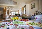 Нощувка на човек със закуска и вечеря + басейн, парна баня и сауна от КООП Рожен, Пампорово