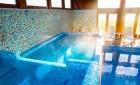 Нощувка на човек със закуска + МИНЕРАЛЕН басейн и релакс пакет в хотел Севън Сийзънс, с.Баня до Банско