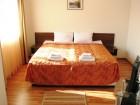 Нощувка на човек със закуска и вечеря + 2 топли минерални басейна и СПА зона от хотел Аквилон Резидънс & СПА, с. Баня