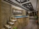 Нощувка на човек със закуска и вечеря + басейни и СПА пакет в Костадиновите къщи хотел Съни Хилс и СПА, Елена