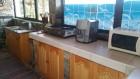 Лято на брега на язовир Доспат! Нощувка на човек + напълно оборудвана кухня и НОВО барбекю от семеен хотел Емили, Сърница