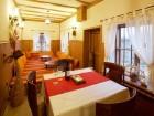 Нощувка на човек със закуска, обяд и вечеря в къща за гости Кафенето на Димчо кехая, Жеравна