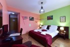 Нощувка на човек със закуска и вечеря + басейн с хидромасаж в хотел Ида***, Банско