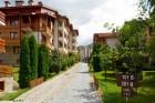 Нощувка на човек със закуска и вечеря + огромен басейн и Уелнес център в хотел Св. Иван Рилски****, Банско