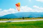 Тандемен полет с парапланер на лебедка край София или Сапарева баня + видеозаснемане от Полети и приключения, снимка 5