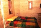 Нощувка със закуска за двама или четирима в къщичка направена от камък, глина и дърво от Еко селище, Омая, снимка 9
