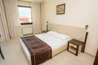 Нощувка на човек със закуска и вечеря + басейн и джакузи в хотел Родопски Дом, Чепеларе, снимка 8