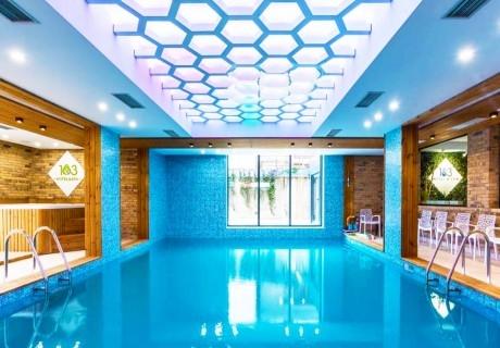 Нощувка със закуска за двама + басейна и СПА с МИНЕРАЛНА вода в НОВИЯ СПА хотел 103°, Сапарева баня
