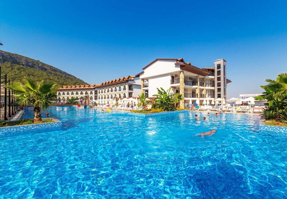 7 нощувки на човек на база All Inclusive + басейн и аквапарк в хотел Ramada Resort Akbuk, Дидим, Турция. Дете до 13г. - БЕЗПЛАТНО!