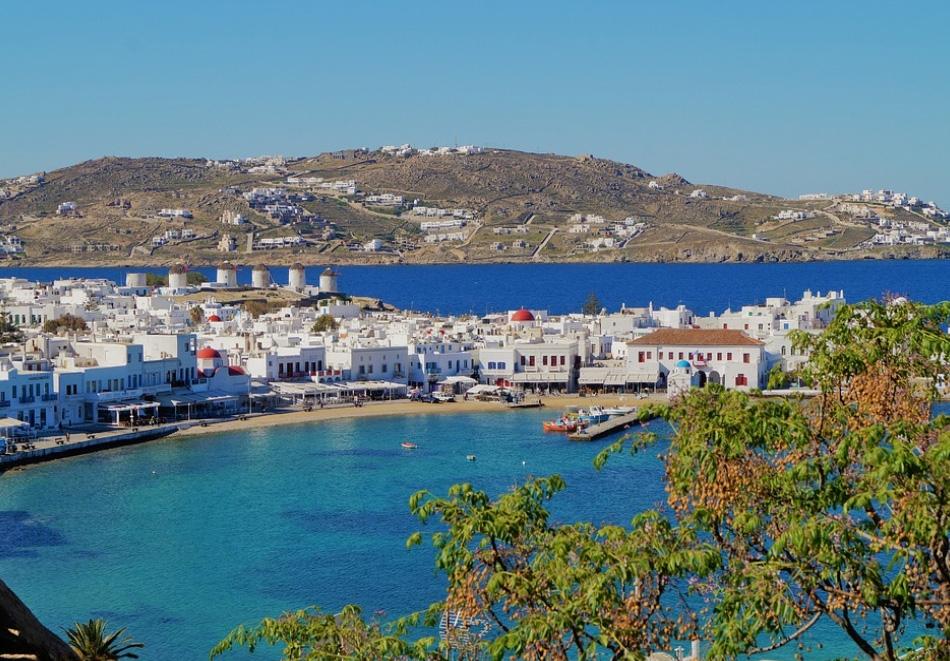 Самолетна екскурзия до о. Миконос! 4 нощувки на човек със закуски + двупосочен билет от туристическа агенция Далла Турс