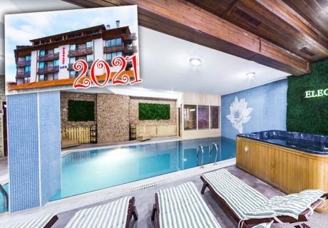 Нова година в хотел Елегант Лукс, Банско! 5 нощувки на човек със закуски, 4 вечери и 1 обяд + топъл вътрешен басейн и релакс пакет. Доплащане по желание за Новогодишен куверт