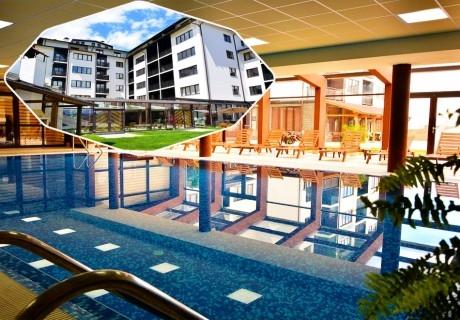 Нощувка със закуска и вечеря на човек + отопляем вътрешен басейн и релакс зона от хотел Роял Банско Апартмънтс. Дете до 12г. - безплатно!
