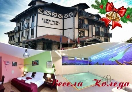 Коледа в Банско! 3 нощувки на човек със закуски и вечери, едната празнична + басейн и сауна от хотел Ида***