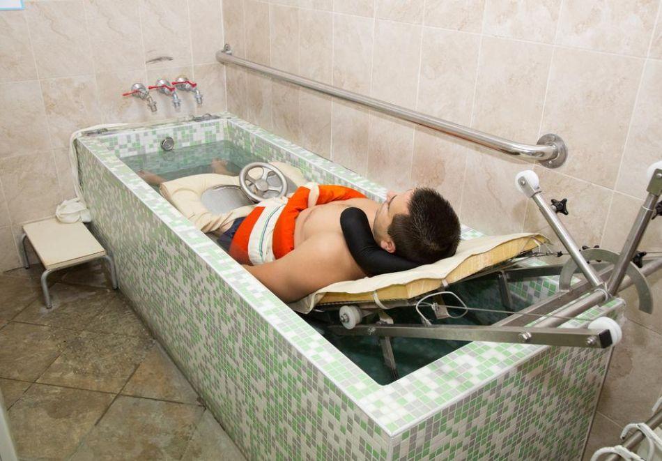 Нощувка на човек със закуска и вечеря + преглед от лекар-специалист + лечебни процедури и минерален басейн от хотел-клиника Д-р Гечеви, Павел Баня, снимка 5