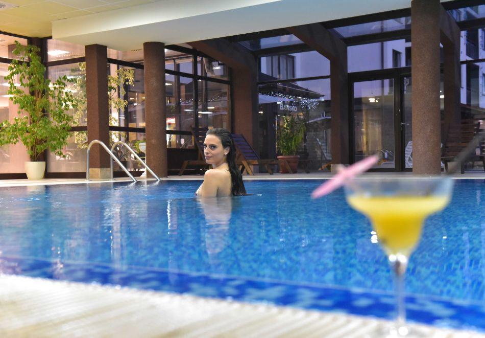 Нова година в Банско! 3 нощувки на човек със закуски и вечери, едната празнична + отопляем вътрешен басейн и релакс зона от хотел Роял Банско Апартмънтс, снимка 12